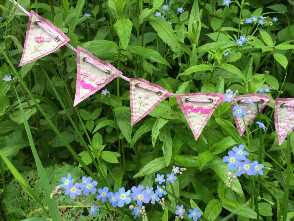 Bunting in the forget-me-nots  www.kateskloths.co.uk