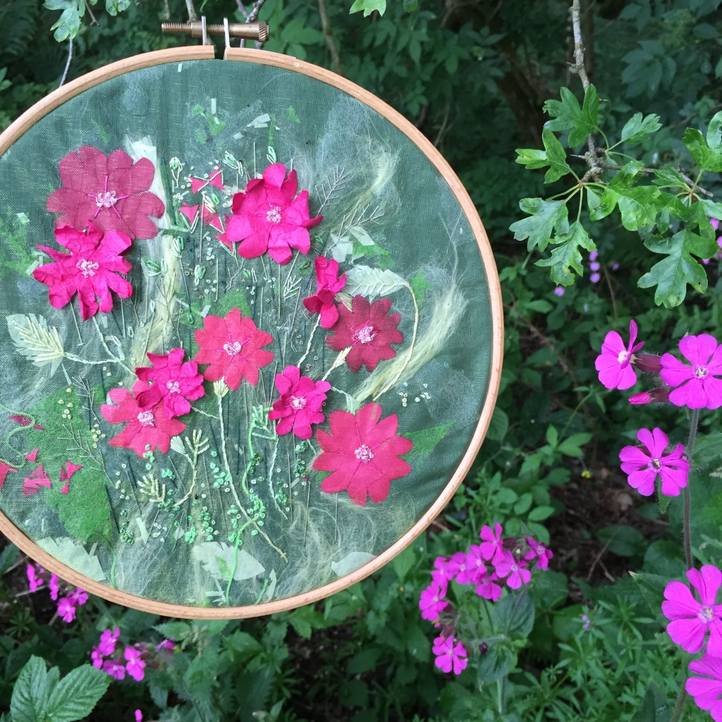 Completed embroidery photographed among the Red Campion www.kateskloths.co.uk