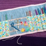The opened roll with storage for hooks, needles, scissors and stitch markers