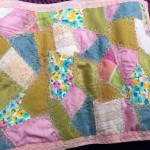 Crazy patchwork with free machine embroidery on crochet storage roll/